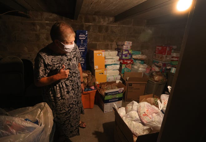 Sister Karen Dietz, interim director of Bethany House, looks over items stored in the basement of the building. It is one of the few food shelves that hands out diapers and other personal care items.