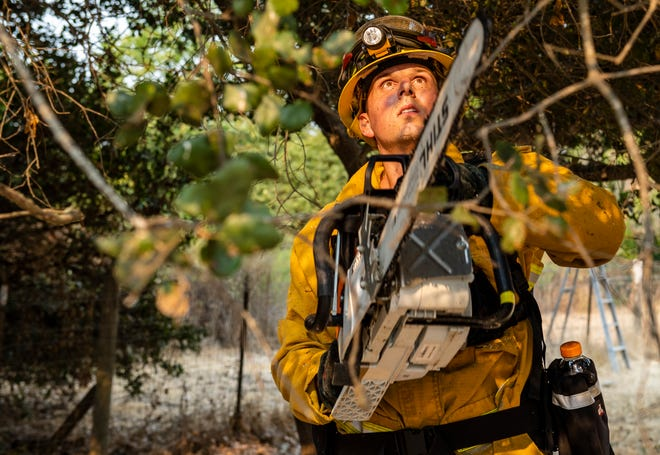 Firefighters are working tirelessly to prevent further damage and clean up debris in Salinas, Calif., on Aug. 18, 2020. As fires rage throughout California, Monterey County faces three wildfires. After a dry lightening storm that started the River Fire Sunday morning, it has consumed 10,672 acres.