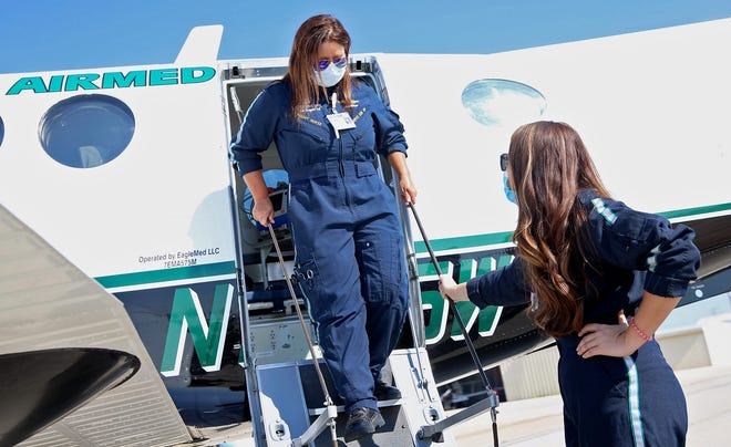 Cathy Murphy, center, Paige Ledbetter, right, look over the newest addition to the fleet of emergency medical aircraft in San Angelo at the regional airport on Wednesday, Aug. 19, 2020.