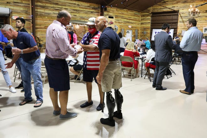 U.S. Rep. Brian Mast (center) defeated Nick Vessio securing 86% of the vote in the Republican primary for Florida's 18th Congressional District. Mast attended the St. Lucie County Republican primary election watch party at The Barn at Oleander on Tuesday, Aug. 18, 2020, in St. Lucie County.