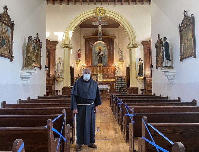 """The Rev. Miguel Briseno is shown after a church service at the Ysleta Mission. """"The hope comes from our belief in our creator, in Jesus Christ,"""" he said, """"but also through prayer, knowing that we're not alone, that there are many others who find themselves in the same situation."""""""