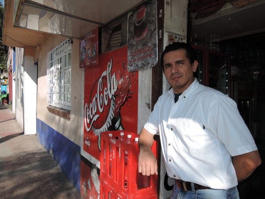 Rodolfo Villanueva, 37, and his family run a mom-and-pop store near the Mexican president's residence. The business depends on selling soda for much of its business so Villanueva believes a proposed tax on sugary drinks will drive down sales, at least in the short term.