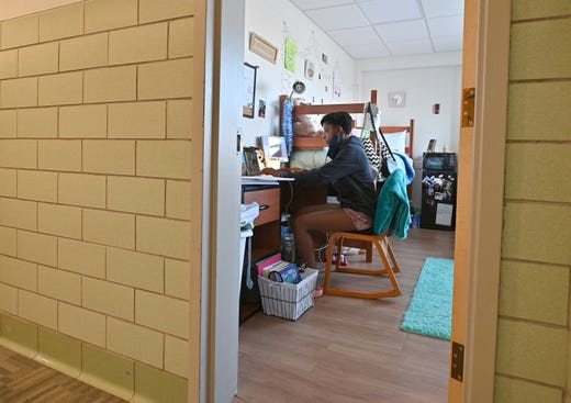 Kyalynn Moore-Wilson, a freshman, sits at a desk in her dorm room before joining a Zoom meeting for an 'Introduction to Psychology' course as classes begin amid the coronavirus (COVID-19) pandemic on the first day of the fall 2020 semester at the University of New Mexico on Aug.17, 2020 in Albuquerque, N.M.. The course will meet in person four times during the fall semester with the remaining classes and coursework completed online. To help prevent the spread of COVID-19, the university has moved to a hybrid instruction model that includes a mixture of in-person and remote classes. According to the school, about 70 percent of classes are being taught online.