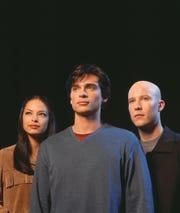 """""""Smallville"""" cast members Kristin Kruek, Tom Welling, center, and Michael Rosenbaum."""