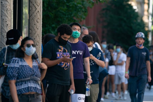 New York University students wait in line to be tested for COVID-19 before school opens on Aug. 18, 2020 in New York.