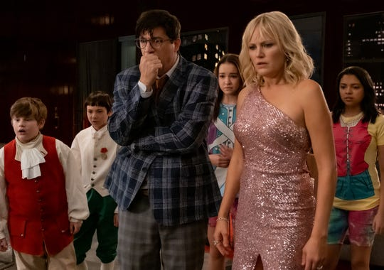 "A married couple (Ken Marino and Malin Akerman) and a bunch of kids (Maxwell Simkins, Lucas Jaye, Sadie Stanley and Cree Cicchino) get embroiled in a heist in the family adventure comedy ""The Sleepover."""