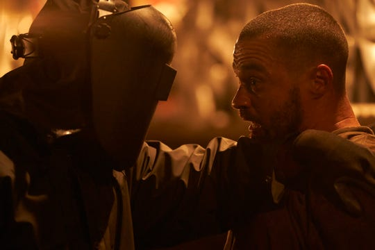 "A comic-book creator (Jesse Williams, right) runs into a real version of his masked slasher character in ""Random Acts of Violence."""