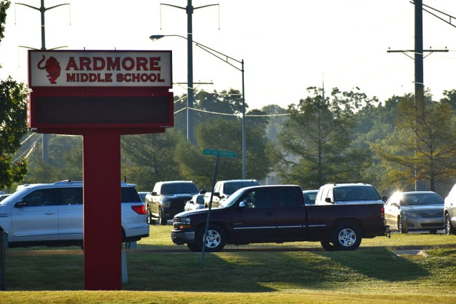 FILE - Vehicles wait to drop off students for the first day of school on Thursday, Aug. 20. Ardmore Middle School moved to distance learning Friday after a positive case of COVID-19 was confirmed. Other schools across the district do not appear to be affected.