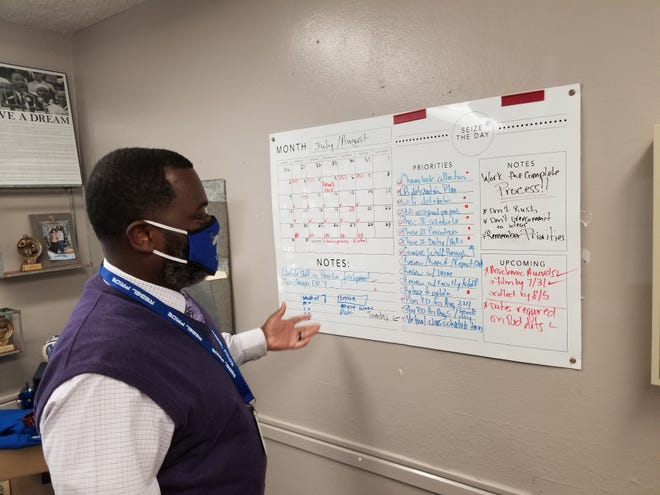 Principal Greg Cook explains his task board and what needs to be done before West Thibodaux Middle School's first day of on-campus classes Monday.