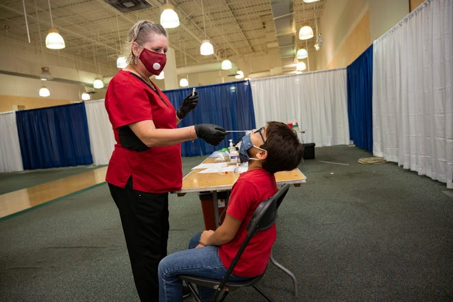 A student gets tested for COVID-19 last month at the Lake Square Mall in Leesburg. [Cindy Peterson/Correspondent]