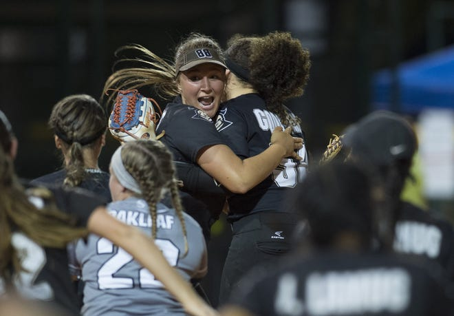 Oakleaf's Angela Agurkis, center left, and Baylee Goddard celebrate with their team after winning their 2017 FHSAA Class 8A final against Wellington.