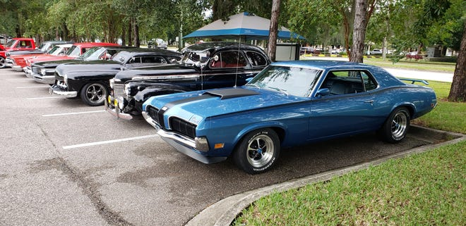 A 1970's Mercury Cougar Eliminator leads off this row of classics from the '40s, '50's and '60s at Cruise Fruit Cove.