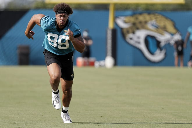 Jaguars tight end Josh Oliver performs a drill during a training camp workout.