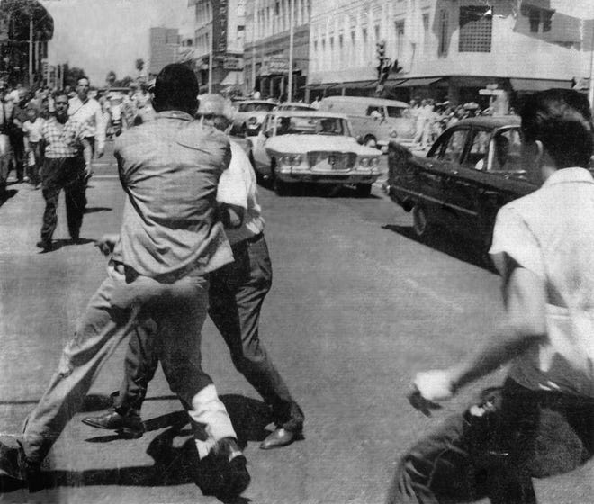 A Life Magazine photo from the Jacksonville Historical Society archives from August 1960 shows a man identified as Charlie Griffin as he was accosted on a Downtown street and was later struck in the head with an ax handle during the civil unrest that followed attempts by members of the Jacksonville branch NAACP Youth Council to sit-in at the F.W. Woolworth's lunch counter and other segregated facilities in Jacksonville, FL.