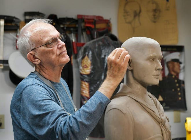 Sculptor Cliff Leonard works on a bust of a fallen U.S. Navy corpsman on Aug. 6 in his home studio in Jacksonville. Leonard is a U.S. Marine veteran who served in Vietnam and has been making busts of fallen Marines for family at no cost.