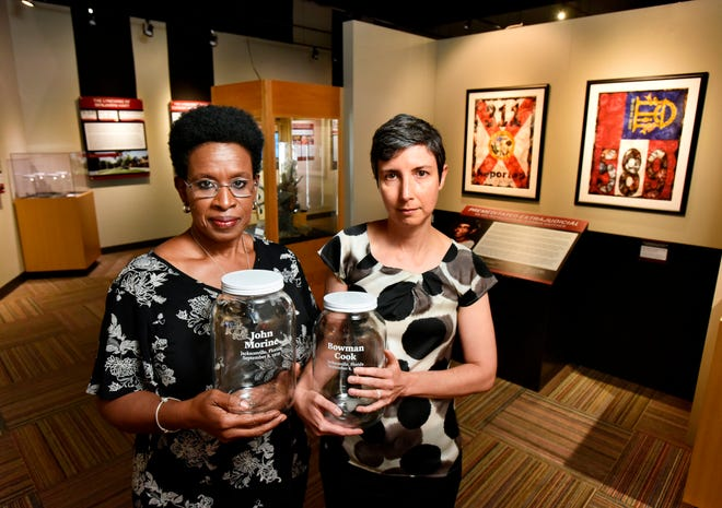 The soil collection ceremony commemorating Benjamin Hart's killing will use jars like these, which Jacksonville Community Remembrance Project co-chairs Lynn Sherman (left) and Melanie Patz displayed during a 2019 lynching exhibit at the Museum of Science & History.