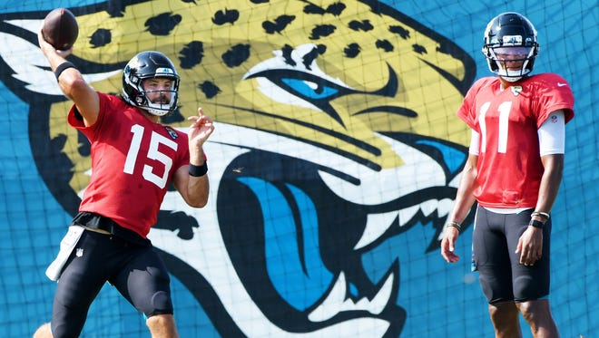 Jaguars quarterback Gardner Minshew said the team has high expectations to win this season. Backup quarterback Joshua Dobbs looks on as Minshew throws a pass during a recently training camp practice.