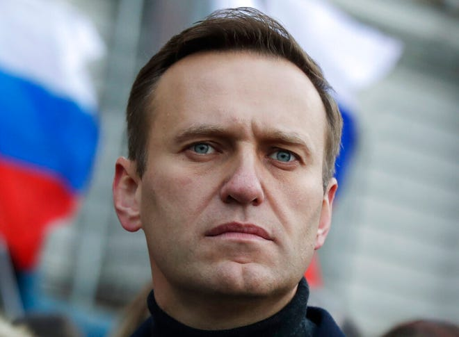FILE - In this Feb. 29, 2020, file photo, Russian opposition activist Alexei Navalny takes part in a march in memory of opposition leader Boris Nemtsov in Moscow, Russia. Navalny has been poisoned and hospitalized on Thursday morning, Aug. 20, 2020 his spokeswoman Kira Yarmysh said on Twitter, Navalny felt unwell on a flight back to Moscow from Tomsk, a city in Siberia. (AP Photo/Pavel Golovkin, File)