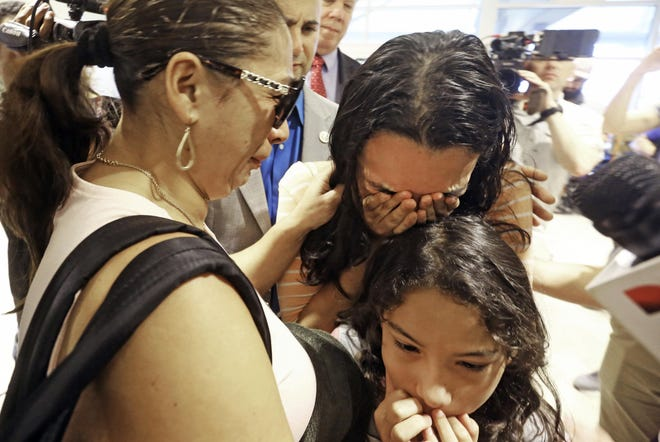 Alejandra Juarez, left, says goodbye to her children, Pamela and Estela, at Orlando International Airport on Aug. 3, 2018. Juarez, the wife of a former Marine, was preparing to self-deport to Mexico in a move that would split up their family.
