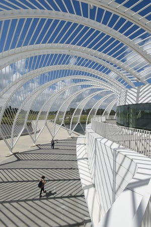 A student walks into the Innovation, Science and Technology building at Florida Polytechnic University in Lakeland.