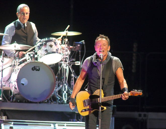 "FILE - Max Weinberg, left, and Bruce Springsteen perform with the E Street Band during their ""The River Tour 2016"" in Baltimore on April 20, 2016. Weinberg, the longtime drummer for Bruce Springsteen and the bandleader for Conan O'Brien's Late Night and The Tonight Show, has been appointed to a local planning and zoning board in the Delray Beach, Fla., where he lives. (Photo by Owen Sweeney/Invision/AP, File)"