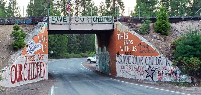 "Mount Shasta's Graffiti Bridge was painted with messages regarding the ""Save Our Children"" movement on Aug. 14, 2020."