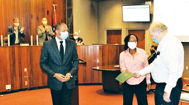 Oak Ridge City Council members applaud as Council member Derrick Hammond, from left, finishes handing a proclamation to Rose Weaver and MartinMcBride honoring the 85 Oak Ridge students who desegregated Oak Ridge High School and Robertsville Junior High in 1955. Weaver and McBride are among the Oak Ridge residents planning activities to mark the anniversary of that historic event.