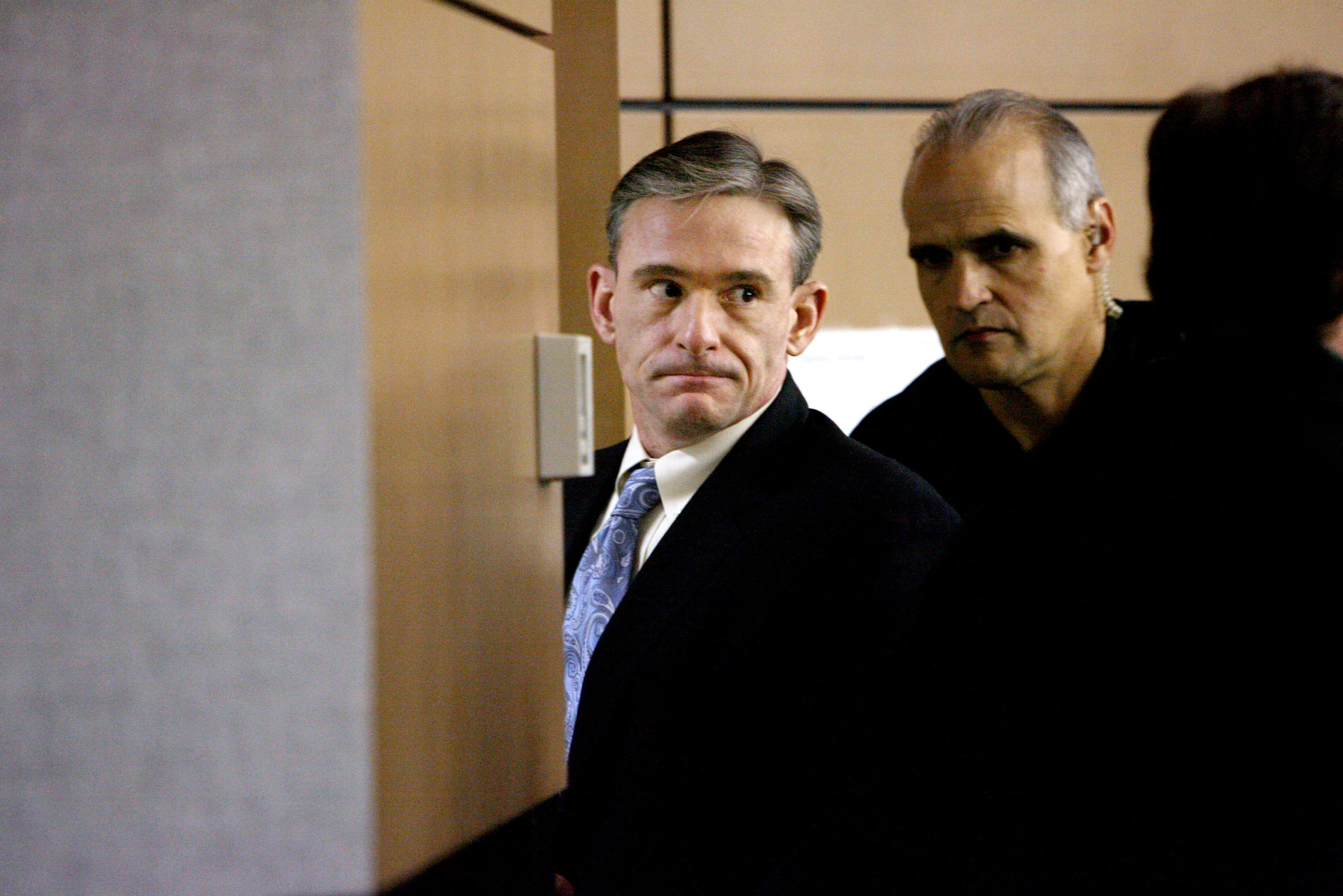 Daniel Lee Alexander, 41, a Palm Beach Gardens handyman accused of killing his roommate and disposing of his severed body in four concrete-filled containers, exits the court for a lunch break before testifying during the third day of the murder trial at the Palm Beach County Courthouse in West Palm Beach on Jan. 7, 2011.