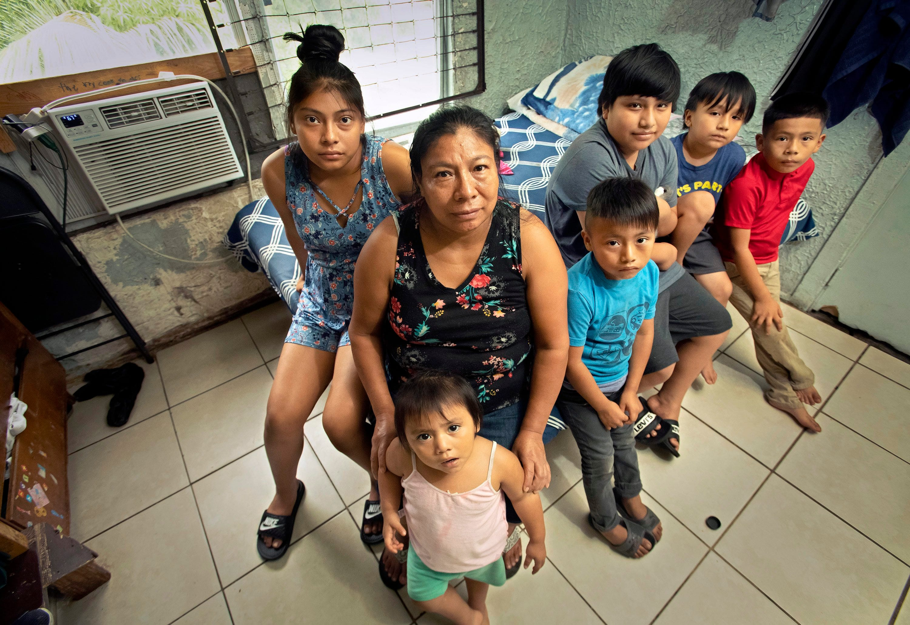 Antonio Sebastian Juan's family still lives in the home where he was killed in May 2018. From left are Belci Ramirez, 14, his stepdaughter; Cristina Ramirez, wife; Adalyn Perez, 2, step granddaughter; Dymer Perez, 6, step grandson; James Sebastian Juan, 11, son; Fidencio Sebastian Juan, 6, son; and Jeffrey Sebastian Juan, 7, son.