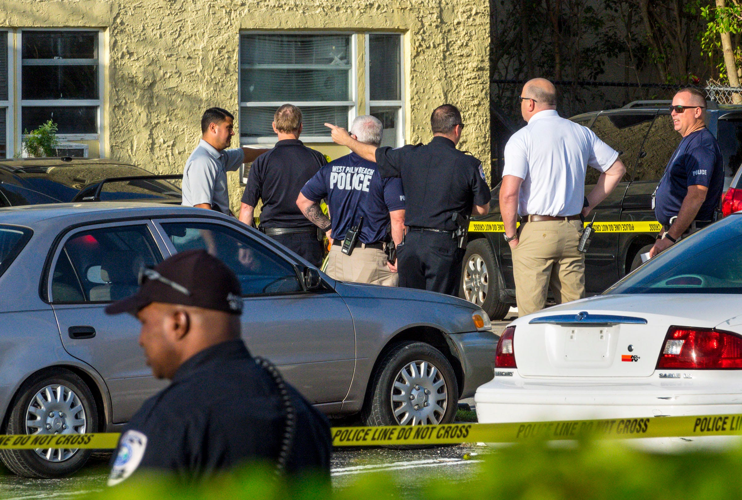 West Palm Beach police investigate the fatal shooting of 41-year-old Antonio Sebastian Juan outside on 37th Street in West Palm Beach on May 4, 2018.