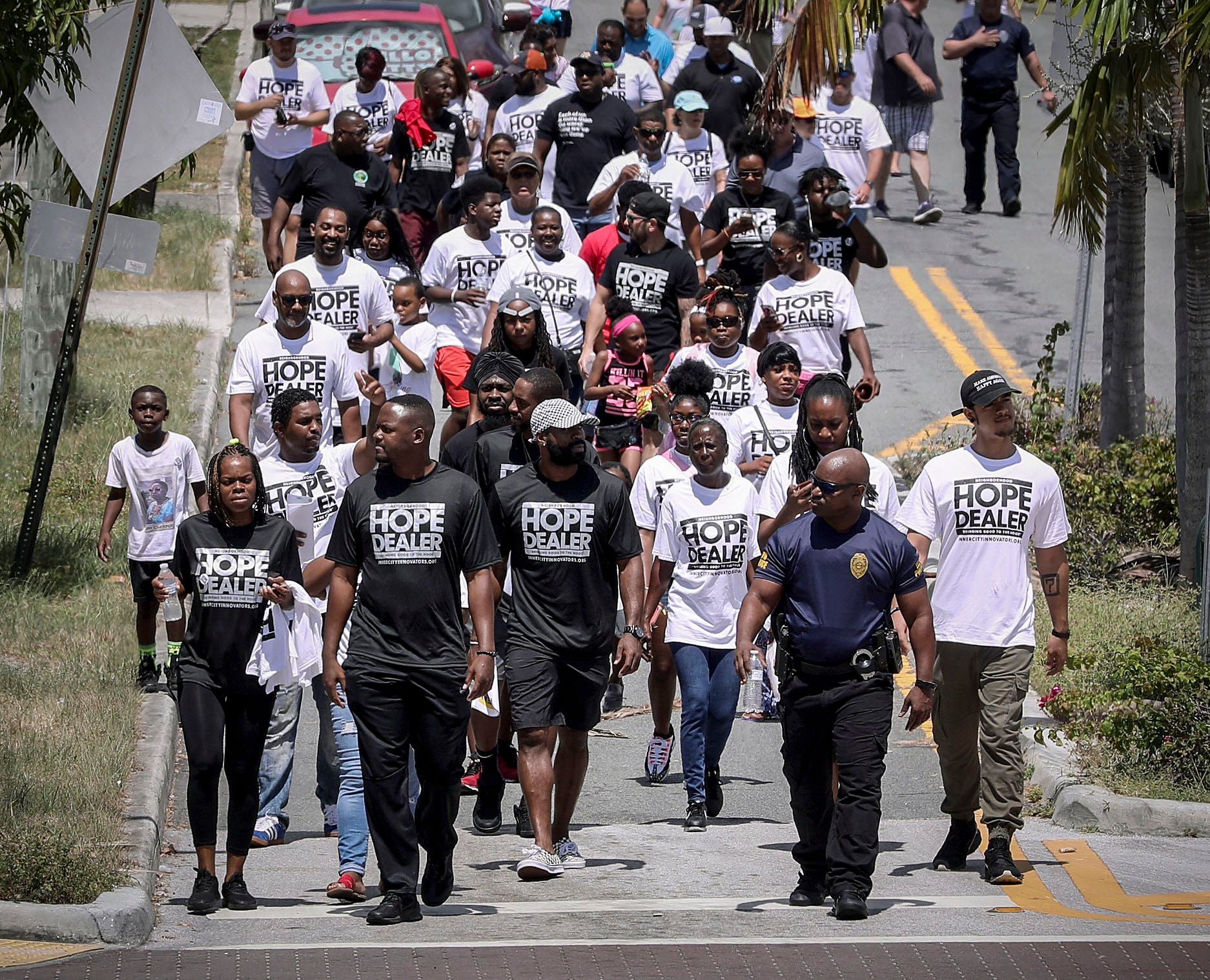 A group of volunteers led by Ricky Aiken of Inner City Innovators participates in a peace walk in West Palm Beach in June 2019.