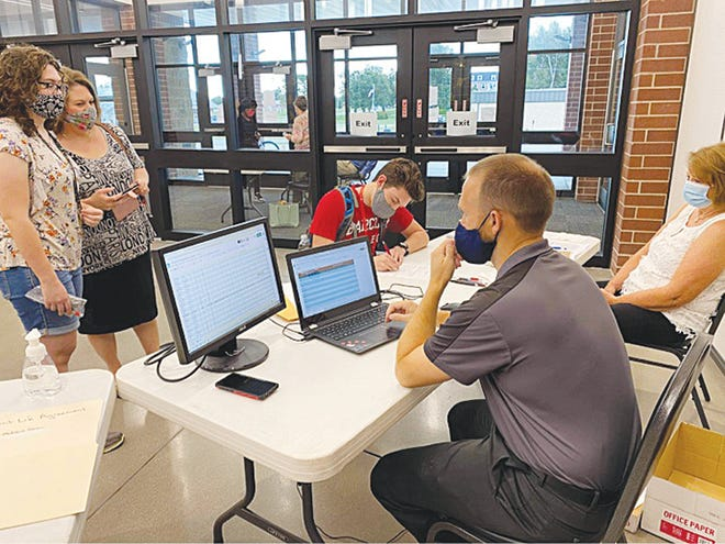 Cassie Frazier (returning student), mom Vickie Frazier, James Frazier (new student), Justin Kendall, director of admissions, and Carolyn Frazier go through the enrollment process at Barclay College.