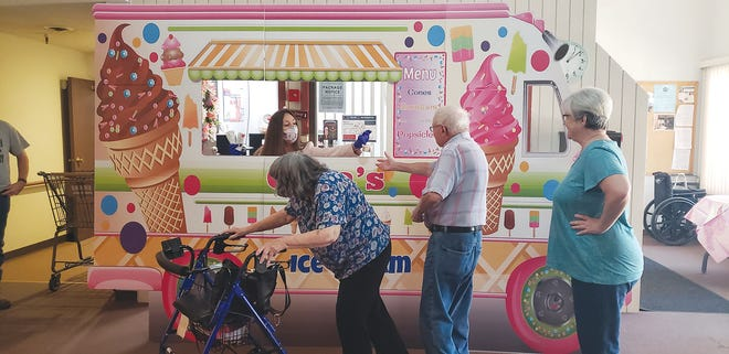 "Gina Qualls, Manager of Hillside Terrace Apartments organized an Ice Cream Social for tennants birthdays in August at the apartment complex at 414 Watson in Pratt. Residents were enjoyed treats from ""Gina's Ice Cream Truck"""