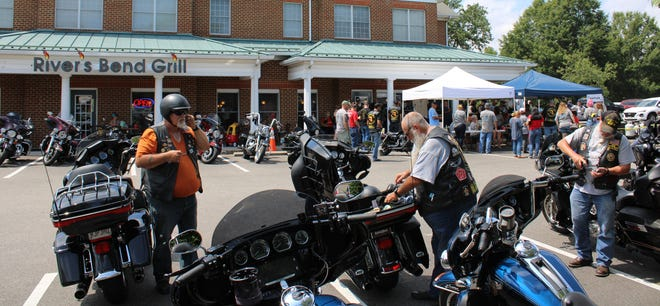 """Riders and attendees mingle where the last """"Ride for Sierra"""" dice run roll took place at the River's Bend Grill in Chester on August 8, 2020."""