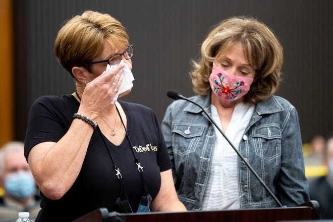 Debbi McMullan, left, and Melanie Barbeau confront Joseph James DeAngelo at the Sacramento County Courthouse during the third day of victim impact statements on Thursday in Sacramento. DeAngelo, a former California police officer, has admitted to being the infamous Golden State Killer, and killed McMullan's mother, Cheri Domingo, and Domingo's boyfriend, Gregory Sanchez.