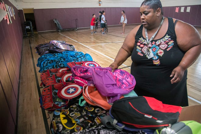 Georgia Brownlee with the Sierra Vista Homes residents council sets out backpacks on Aug. 24, 2017, at Sierra Vista Community Center in Stockton. Sierra Vista Residents Council' Community Care Day on Aug. 25 includes a school supply drive, health information and voter registration opportunities.