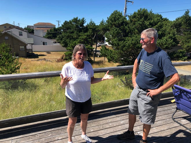 Lynnae and Ed Ruttledge, part-time residents, speak during an interview at their home in Tierra del Mar, Ore., Monday, Aug. 17, 2020.