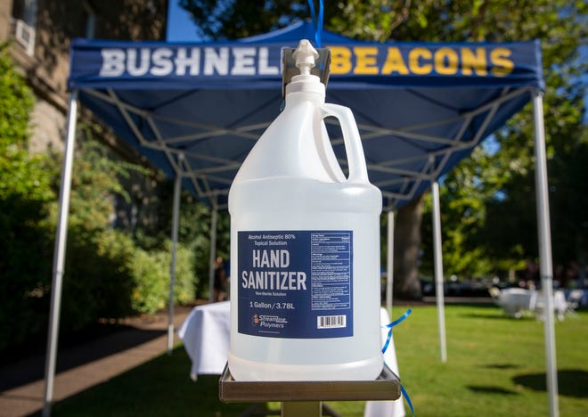 Signs reminding students of social distancing and the placement of hand sanitizer around campus are indicators of how COVID-19 has impacted Bushnell University.
