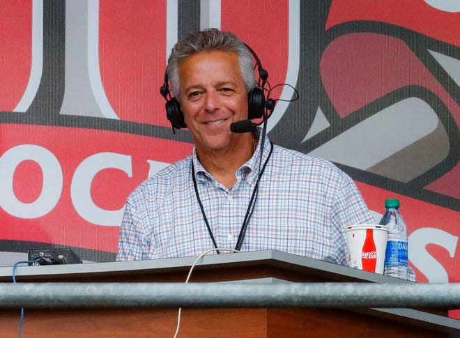 Cincinnati Reds broadcaster Thom Brennaman sits in a special outside booth before the Reds' Sept. 25, 2019, game against the Milwaukee Brewers in Cincinnati. [AP Photo/John Minchillo, File]