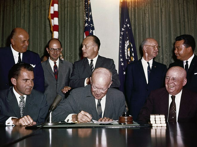 President Dwight D. Eisenhower, signing proclamation Hawaii statehood, as 50th state on Aug. 21, 1959. Seated are Vice President Richard M. Nixon, and House Speaker Sam Rayburn. Standing are Lorrin Thurston, chairman of the Hawaii Statehood Commission, Edward Johnston, Secretary of Hawaii, representing Hawaii, Governor-elect William Quinn, Secretary of the Interior Fred Seaton, Oren E. Long, Democratic senator-elect from Hawaii, and Daniel Inouye, Democratic congressman-elect from Hawaii. [Byron Rollins/THE ASSOCIATED PRESS]