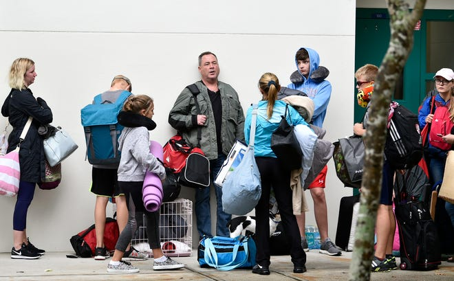 People enter a hurricane shelter at Lakewood Ranch High School in 2017. According to a study by researchers at the University of South Florida, Floridians are less likely to use hurricane shelters because of concerns over COVID-19.