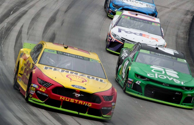 NASCAR Cup Series drivers compete at Dover International Speedway in 2019.