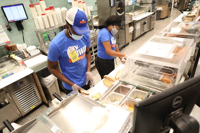 Blaise Wakinson, left, and Tay Williams make subs at the deli in the Wawa store on University Avenue in late August. As of Oct. 29, Gainesville will have four Wawa stores, with another one in the planning stages west of Interstate 75 on Archer Road.