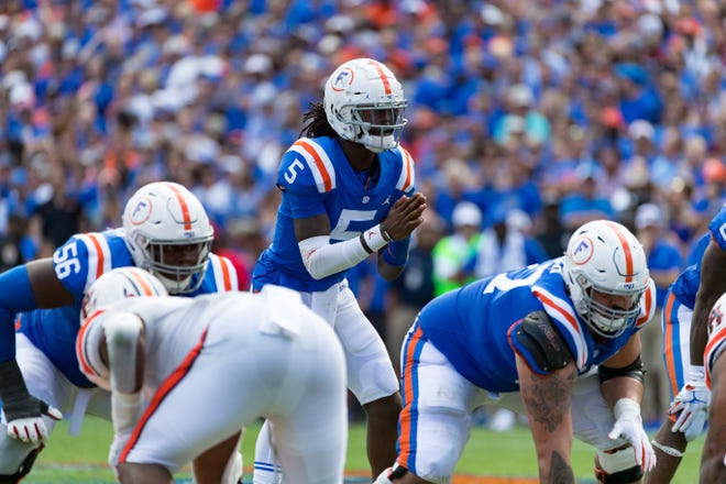 Florida quarterback Emory Jones awaits for the snap from center against Auburn in last year's game at Ben Hill Griffin Stadium.