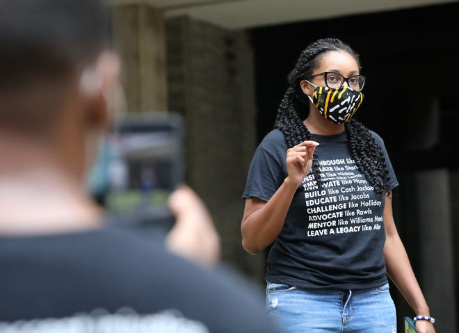 Ebony Love, a 3rd year law student at the University of Florida Levin College of Law and one of the protest organizers, talks about why Professor Michelle Jacobs is uniquely qualified to teach her classes such as Critical Race Theory, as a group protests Jacobs not being allowed to teach remotely due to Covid-19, on campus at in the courtyard of the law school, in Gainesville Fla. Aug. 20, 2020. Professor Michelle Jacobs is Black, she teaches several law classes that deal with race, she also does not live in Gainesville, but has traveled to Gainesville weekly for years to teach her classes. The law school is not allowing Jacobs to teach remotely. Student gathered a petition and held a protest to demand the college allow Jacobs to teach her classes remotely.  [Brad McClenny/The Gainesville Sun]