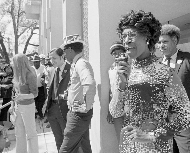 In this March 11, 1972, photo, Rep. Shirley Chisholm, D-NY, addresses a crowd on the steps of the Jackson County courthouse in Marianna. Chisholm was campaigning in Florida's presidential primary. Running as a Democrat, Chisholm became the first black major-party presidential candidate. [AP Photo/Bill Hudson, File]