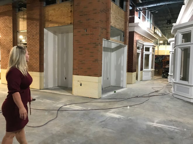 Bethanne Mashburn, owner of The Alley, points out the arcade game rooms that will be located near the Gadsden Mall entrance to facility.