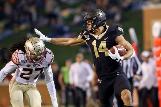 Wake Forest receiver Sage Surratt, right, fends off Florida State defensive back Akeem Dent during an October game last season.