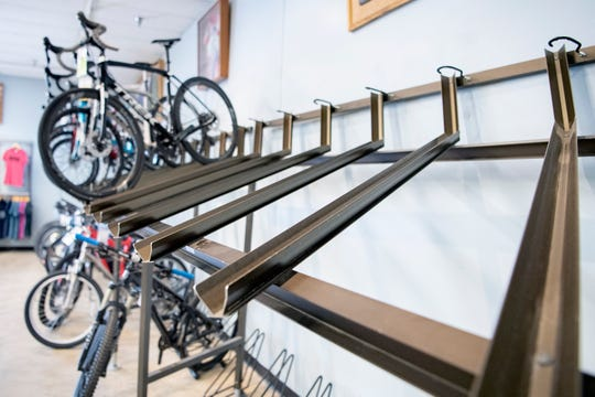Racks meant to hold bicycles for sale sit empty at Liberty Bicycles on Aug. 19, 2020. Bicycles have been in short supply all over due to the coronavirus pandemic.