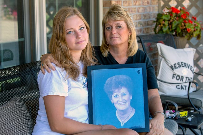 Tammy Simendinger, right, and her daughter Christina, 15, sit on the porch of her mother's home in Harrison.  Tammy said her mother, Crystal Baumann, 77,  did everything right but still contracted the coronavirus. Doctors are not expected for Baumann to survive.